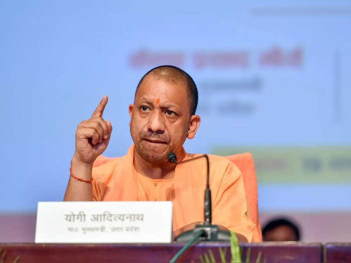 Lucknow: Uttar Pradesh Chief Minister Yogi Adityanath speaks during an event on ...