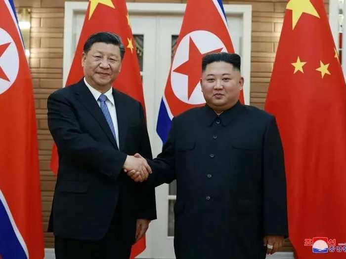 North Korean leader Kim Jong Un shakes hands with Chinas President Xi Jinping during Xis visit in Pyongyang, North Korea in this undated photo released on June 21, 2019 by North Koreas Korean Central New.