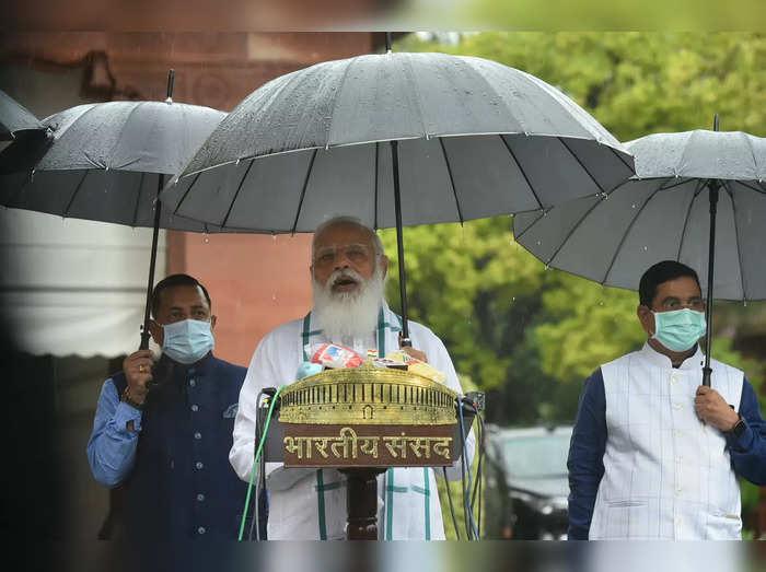 New Delhi: Prime Minister Narendra Modi addresses the media, as it rains on the ...