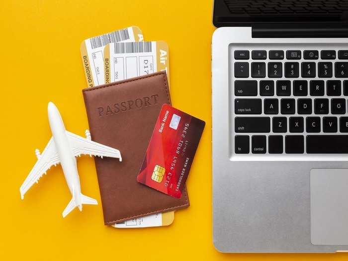top-view-passport-laptop-arrangement