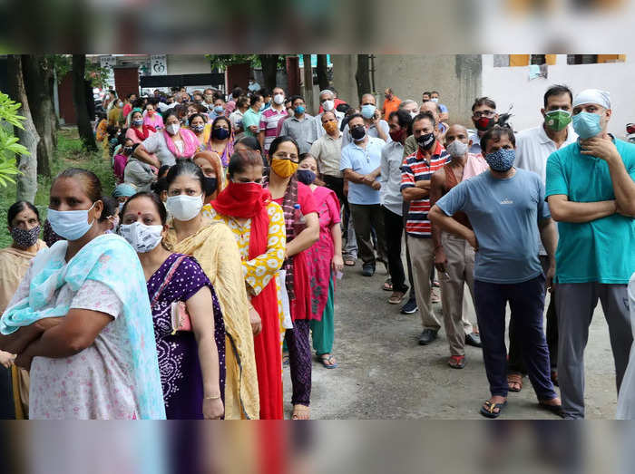 Jammu: People wait to receive a dose of COVID-19 vaccine at a vaccination centre...