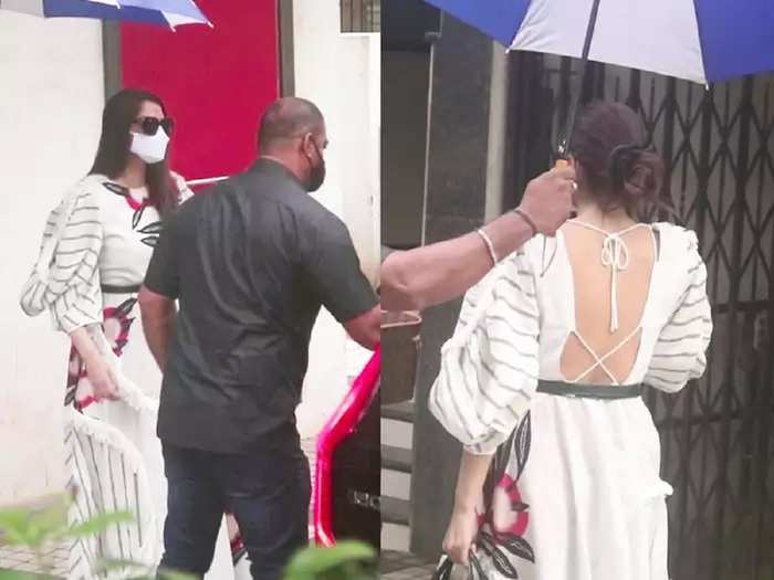 bollywood actress sonam kapoor wore bold and stylish backless white dress for clinic visit