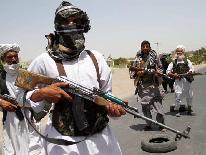 Former Mujahideen hold weapons to support Afghan forces in their fight against Taliban, on the outskirts of Herat province (1).