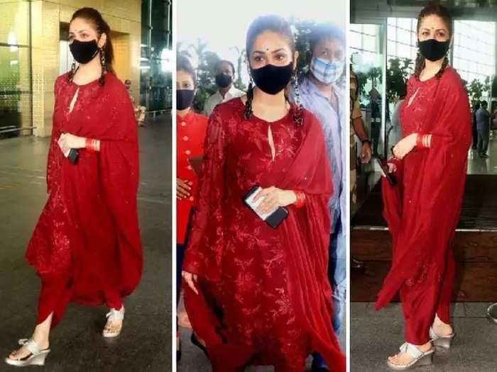 bollywood actress yami gautam wore red color dhoti kurta dress see her latest glamorous airport look