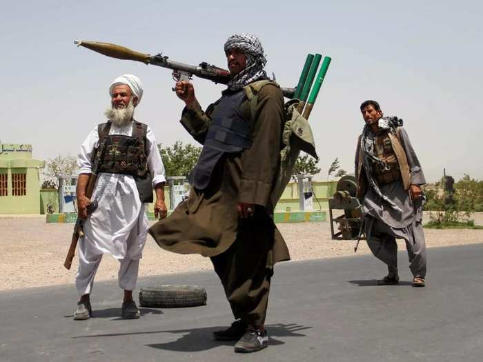 Former Mujahideen hold weapons to support Afghan forces in their fight against Taliban, on the outskirts of Herat province.