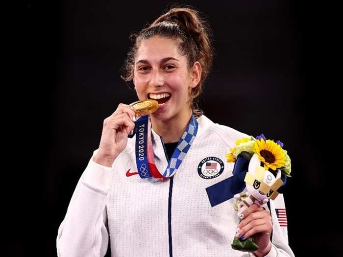 tokyo medal bite olympic