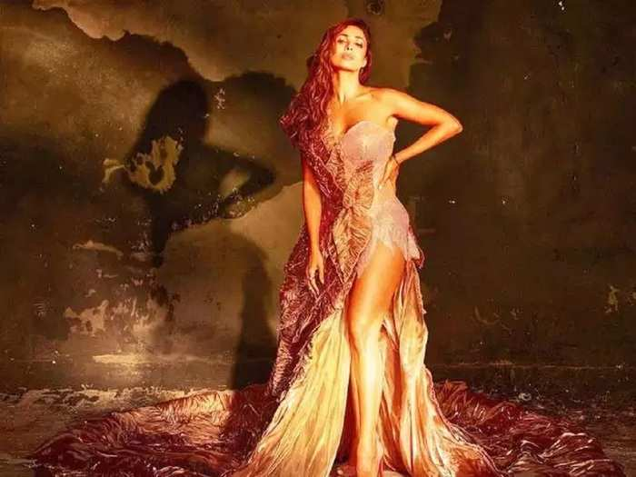 malaika arora looking hot in one shoulder gold and silver gown designed by patrycja kujawa latest bold photoshoot