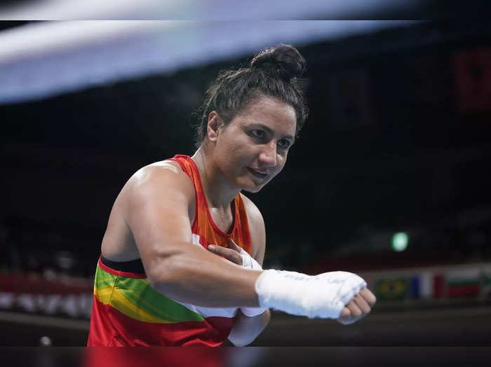 Tokyo: Indias Pooja Rani gestures to the referee after winning her womens mid...