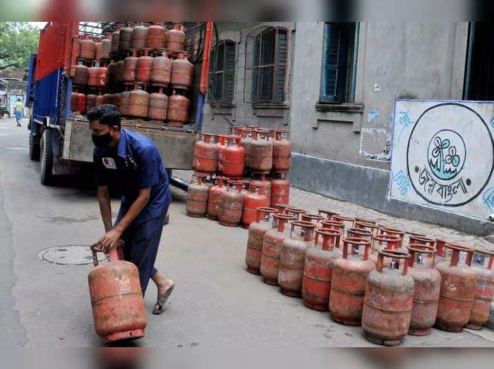 Kolkata: A worker arranges loaded LPG gas cylinders before their delivery, in Ko...