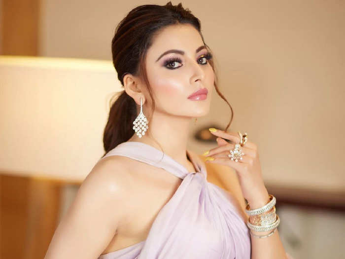 urvashi rautela oozes sexy vibes in versace dress and corset top
