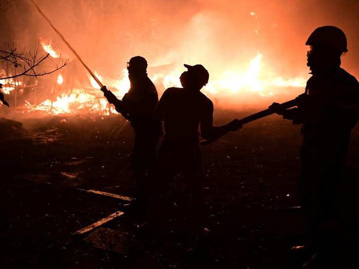heat fuels wildfires in greece thousands flee homes
