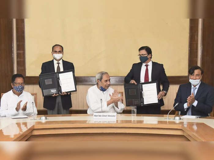 Bhubaneswar: Odisha Chief Minister Naveen Patnaik along with ArcelorMittal Chair...