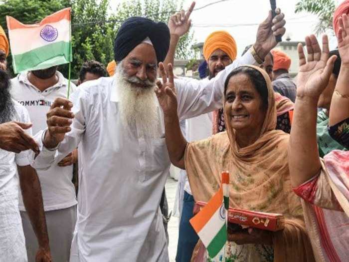 friends and relatives of hockey player gurjant singh in punjab celebrates olympic bronze medal