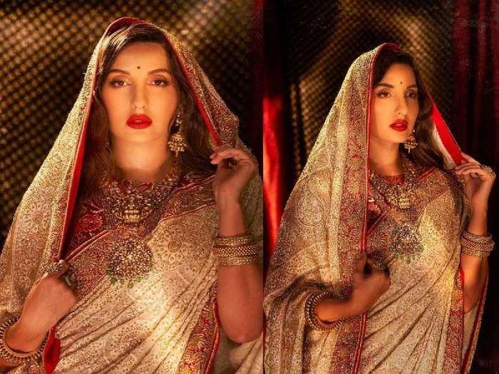 nora fatehi looks super gorgeous in chikankari golden saree for photoshoot