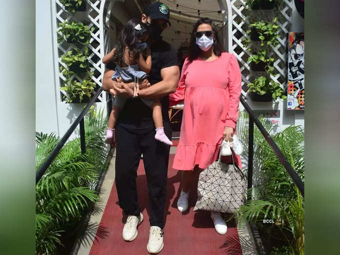 Neha with husband and daughter