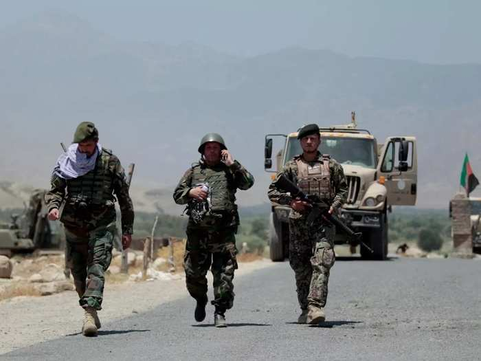 Afghan soldiers recapture checkpoint from the Taliban, in Alishing district of Laghman province.