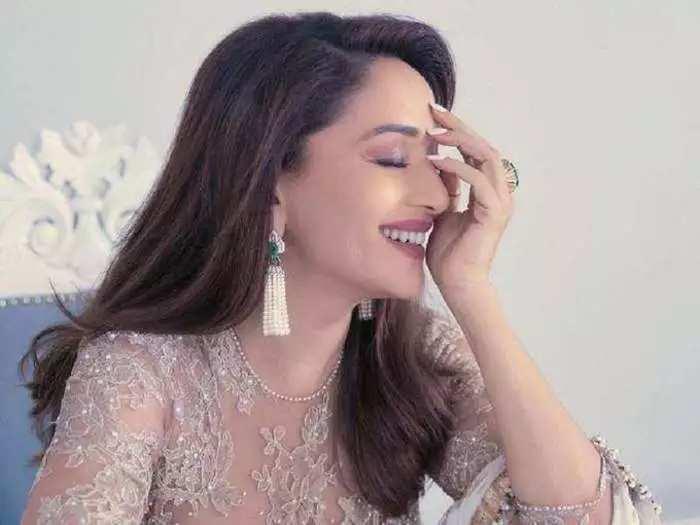 bollywood actress madhuri dixit wore pastel shade sheer floral pattern saree