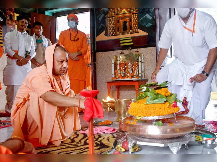 Gorakhpur: UP Chief Minister Yogi Adityanath performs a ritual during his visit ...