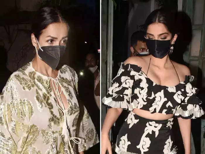 bollywood actress sonam kapoor looking hot and glamorous in skirt top than malaika arora kaftan dress look