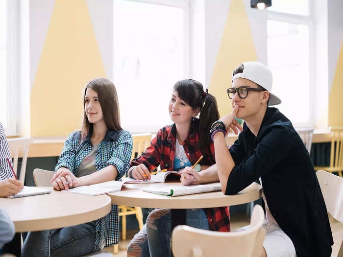 classmates-sitting-learning-desk
