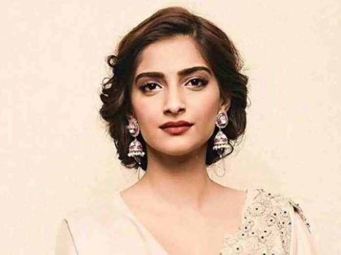 sonam kapoor looks stylish in blue lace midi dress with costly watch