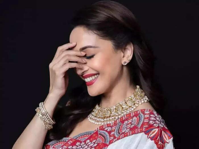 bollywood actress madhuri dixit looking glamorous and bold in yellow color printed co-ord set by diya rajvvir fashion label