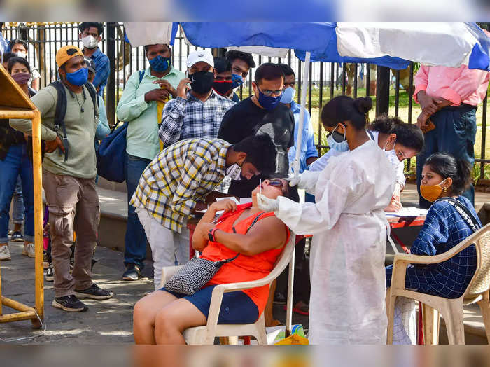 Mumbai: A medic conducts COVID-19 testing of a tourist at Gateway of India as ot...