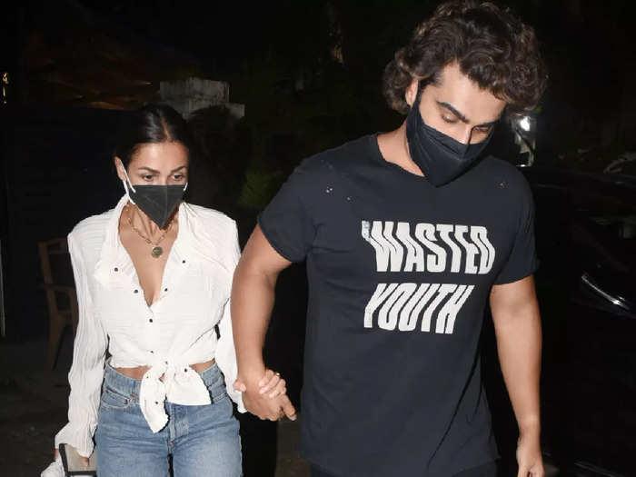 malaika arora dresses in white shirt and shorts for date night with boyfriend arjun kapoor