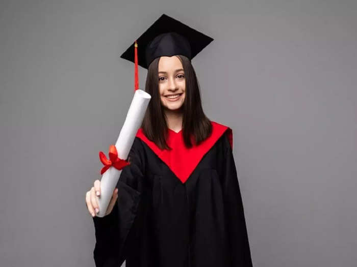 happy-student-with-graduation-hat-diploma-grey_231208-12981