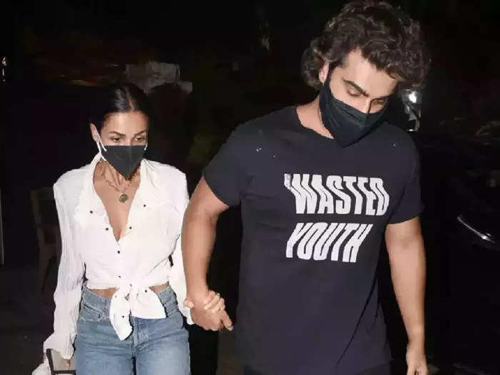 bollywood actress malaika arora wore white shirt denim shorts for date with boyfriend arjun kapoor