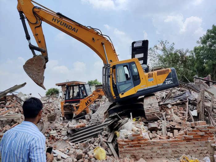 Faridabad: Faridabad Municipal Corporation workers demolish structures at Khori ...