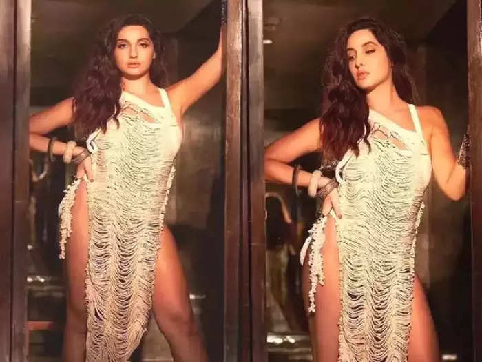 bollywood actress nora fatehi looking bold and hot in bodycon thigh high slit dress new photoshoot viral