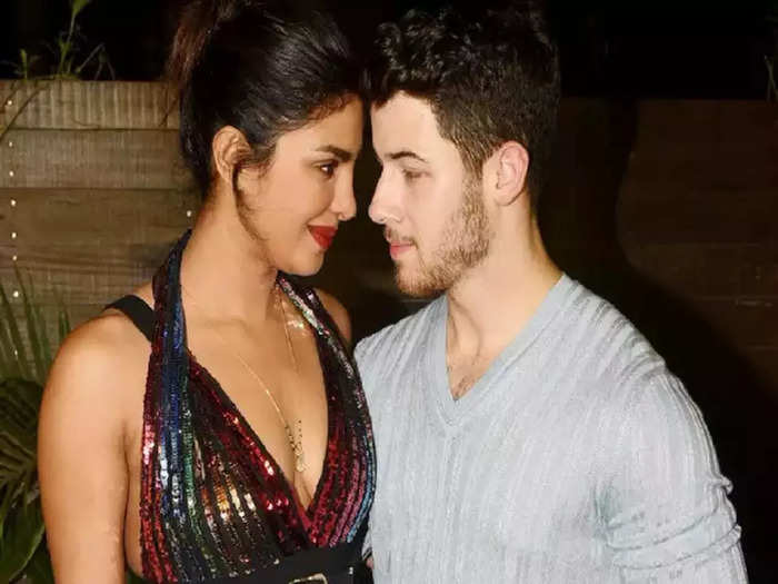 bollywood actress priyanka chopra wore black color slit gown dress for lunch date with nick jonas see her sexy look