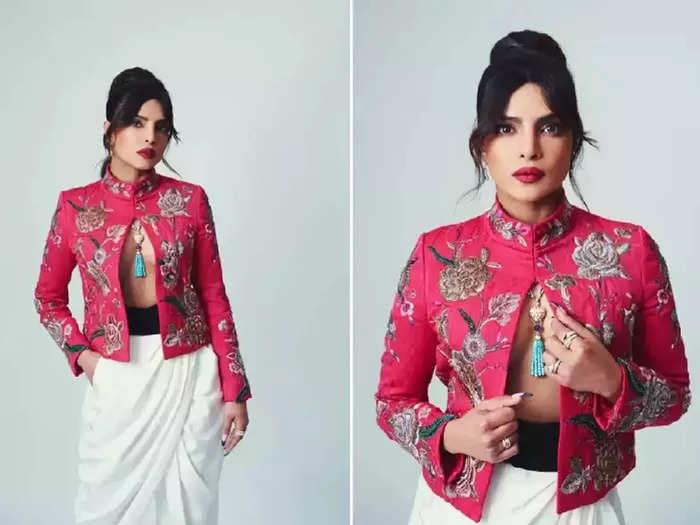 actress priyanka chopra looking hot in front open white top black bottom see her bold and glamorous mumbai airport look