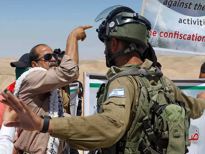 Palestinians protest against Israeli settlements, in West Bank (2).
