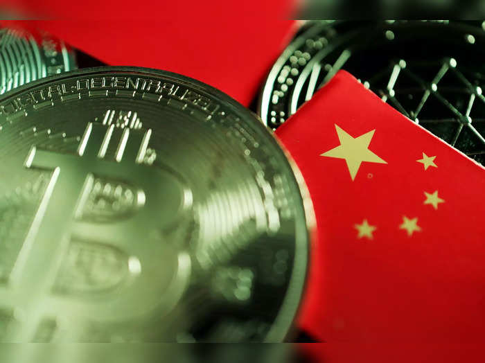 FILE PHOTO: Illustration picture of China flag and cryptocurrencies