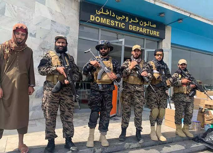 Kabul_ Taliban fighters stand guard inside the Hamid Karzai International Airpor....