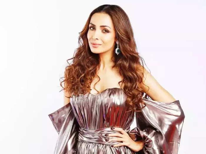 when actress malaika arora flaunts her baby bump in bold dress during fashion show ramp walk