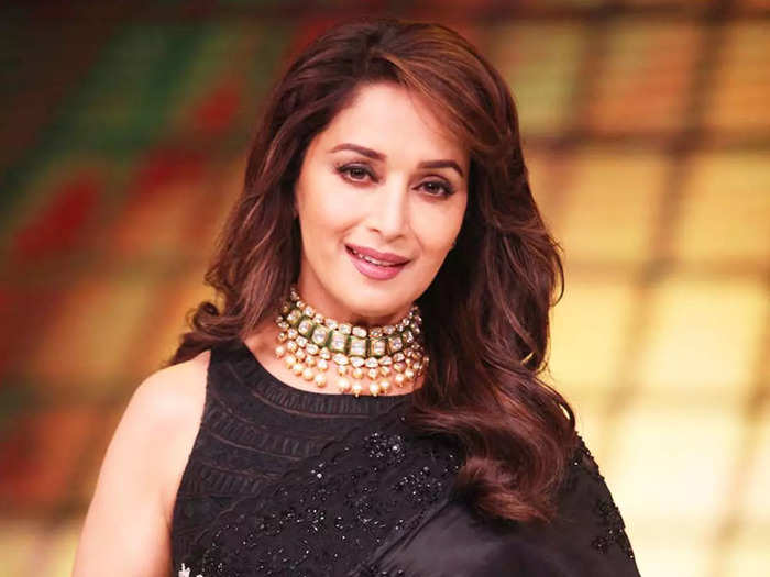 madhuri dixit looks drop dead gorgeous in sheer black saree with halter neck blouse
