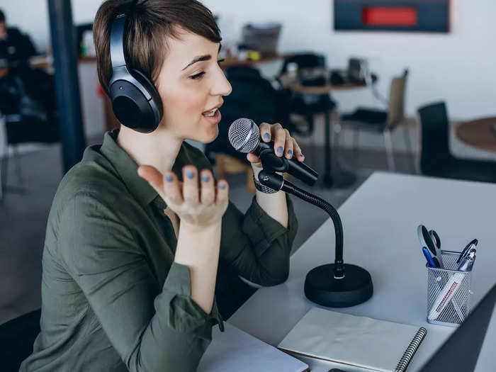 young-woman-with-microphone-recording-voice-acting