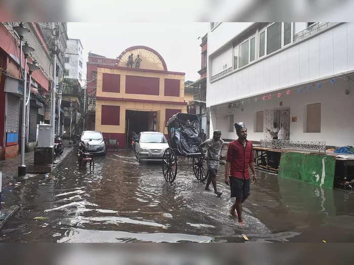 Kolkata: A Durga Puja pandal submerges in water after rain ahead of the Durga Pu...